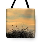 Silhouette Of Grass And Weeds Against The Color Of The Setting Sun Tote Bag