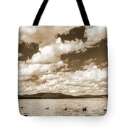 Silhouette Of People Standing In Lake Tote Bag