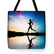 Silhouette Of Woman Running At Sunset Tote Bag
