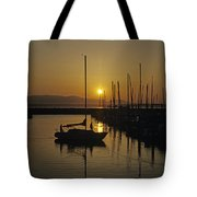 Silhouetted Man On Sailboat Tote Bag