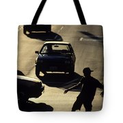 Silhouetted Skateboarder Tote Bag