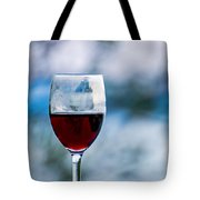 Single Glass Of Red Wine On Blue And White Background Tote Bag