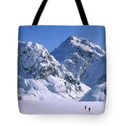 Skiers Cross Frozen Lake Harris Tote Bag