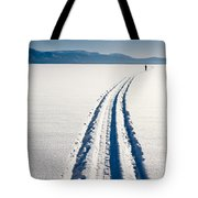 Skiing Person On Frozen Lake Tote Bag
