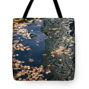 Skyscrapers' Reflections And Fallen Autumn Leaves Tote Bag