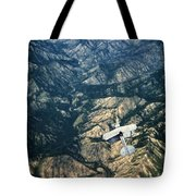 Small Plane Flying Over Mountains Tote Bag