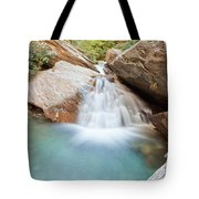 Small Waterfall Casdcading Over Rocks In Blue Pond Tote Bag