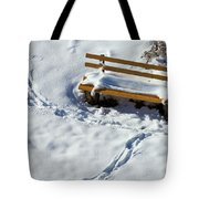 Snowy Foot Prints Around Snow Covered Park Bench Tote Bag