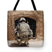 Soldier Searches A Compound Tote Bag by Stocktrek Images