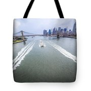 Speed Boats And Barge At East River In Front Of The Brooklyn Bridge And Manhattan Skyline Tote Bag