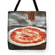 Sprinkling Cheese On Home Made Pizza Tote Bag