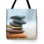 Stack Of Beach Stones On Sand Tote Bag by Michal Bednarek