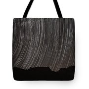 Star Trails Above A Valley Tote Bag by Amin Jamshidi