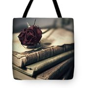 Still Life With Books And Dry Red Rose Tote Bag