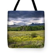 Storm Clouds Over The Rockies Tote Bag