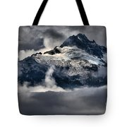 Storms Over Jagged Peaks Tote Bag