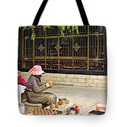 Street Shopkeeper In Lhasa-tibet Tote Bag