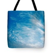 Strong Winds Forming Cirrus Clouds With A Deep Blue Sky. Tote Bag