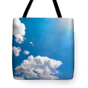 Sun Burst On A Blue Sky And Clouds Tote Bag