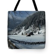Sun On A Snowy Meadow Tote Bag