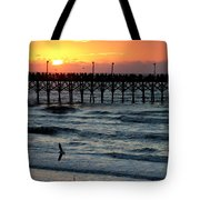 Sun Over Pier And Bird In Surf Tote Bag