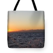 Sun Rising Through Clouds In Rough Waters Tote Bag