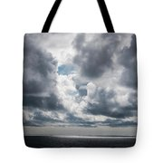 Sunlight Breaks Through The Clouds Tote Bag