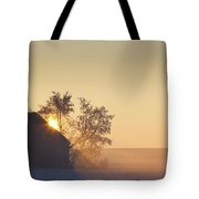 Sunlight Shining Behind A House In A Tote Bag