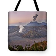sunrise at vulcano Bromo with sea of sand vulcano Semeru with eruption Java Indonesia Tote Bag