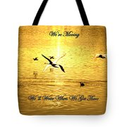 Swans Flying Over The Water Tote Bag