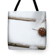Sweetgum Seed Pod In The Snow Tote Bag