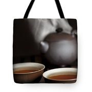 Tea In Cups With A Steaming Pot In The Tote Bag