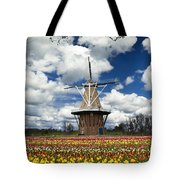 The Dezwaan Dutch Windmill Among The Tulips On Windmill Island In Holland Michigan Tote Bag