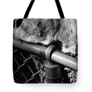 The Fence Eating Tree Tote Bag