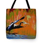 The Great Blue Heron Jumps To Flight Tote Bag