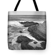 The Jagged Rocks And Cliffs Of Montana De Oro State Park In California In Black And White Tote Bag