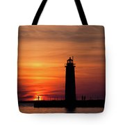 The Muskegon Lighthouse An A Lone Man Fishing Tote Bag