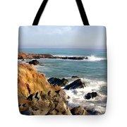 The Rocky Coastline Meets The Ocean Tote Bag