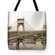 The St. Johns Bridge Is A Steel Suspension Bridge That Spans The Willamette River Tote Bag