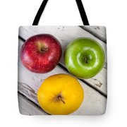 Thee Apples On A Table Tote Bag