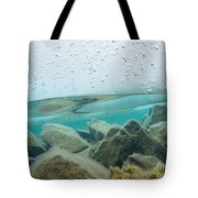 Thick Ice Sheet Underwater Over Rocky Lake Bottom Tote Bag