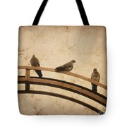 Three Pigeons Perched On A Metallic Arch. Tote Bag