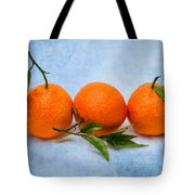 Three Tangerines Tote Bag by Alexander Senin