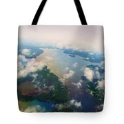 Through The Clouds. Rainbow Earth Tote Bag by Jenny Rainbow