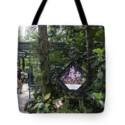 Tourist Doing Photography And Viewing Plants In A Garden Tote Bag