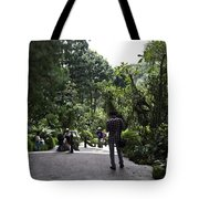 Tourists Inside A Downward Sloping Section In The Orchid Garden Tote Bag