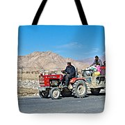 Tractor Towing A Wagon Along The Road To Shigatse-tibet Tote Bag