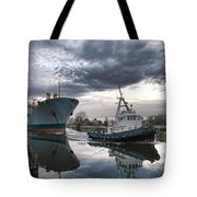 Tugboat Pulling A Cargo Ship Tote Bag