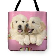 Twin White Labs In Pink Basket Tote Bag by Greg Cuddiford
