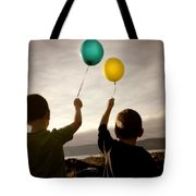 Two Children With Balloons Tote Bag